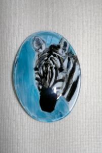 Miniature zebra painting on a brooch