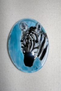 Miniature zebra painting on a brooch